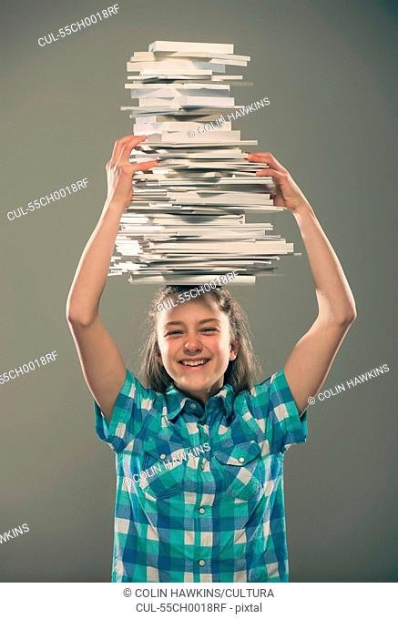 Girl carrying books on head