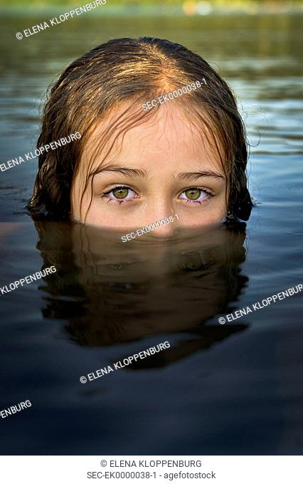 Italy, Girl (10-12) deeply immersed in water