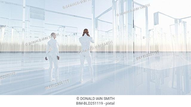 People standing near glass maze