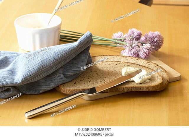 Close-up of brown bread with butter on breakfast table