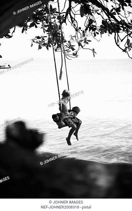 Boy on swing at beach