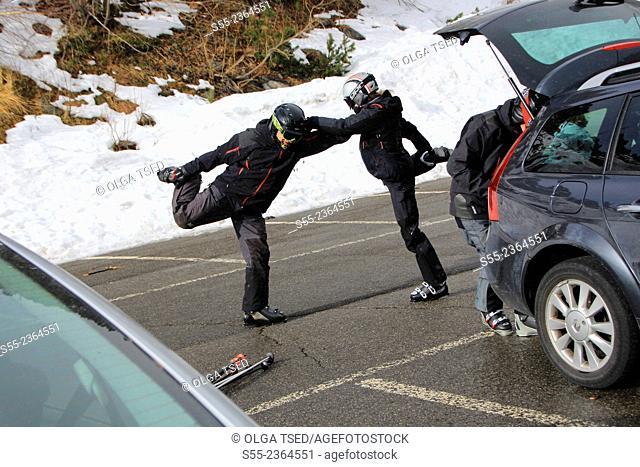 Skiiers doing excercises before skiing. Andorra