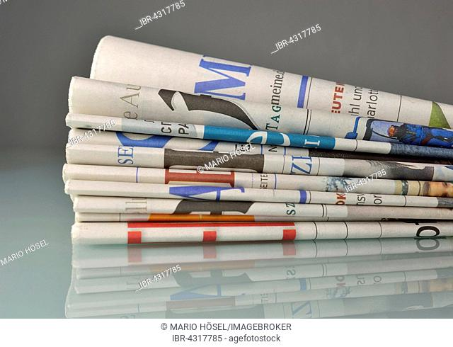 Various newspapers in a stack of newspapers, Germany