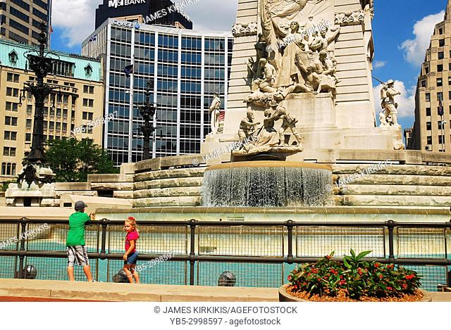 Two young children enjoy the sites of the Soldiers and Sailors Monument in Indianapolis, Indiana