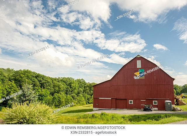 Red barn with painted quilt pattern in Garrett County, Maryland, USA
