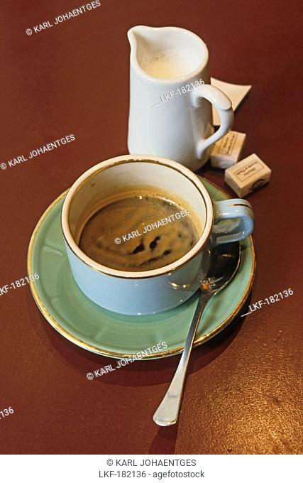 A cup of coffee and a jug of milk, Cafe au lait in a Cafe, Paris, France
