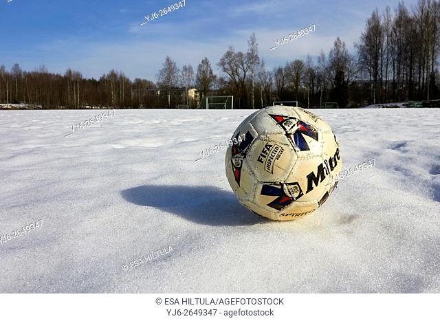 worn-out football on snow