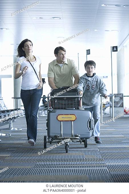 Family hurrying through airport