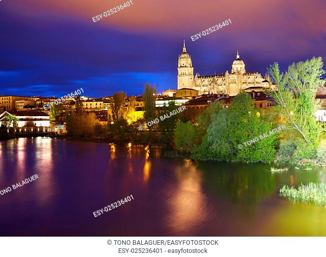 Salamanca skyline sunset with Tormes river in Spain