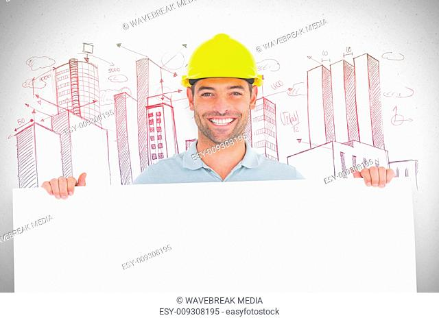 Composite image of happy handyman holding placard on white background