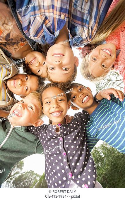 Children huddled together outdoors
