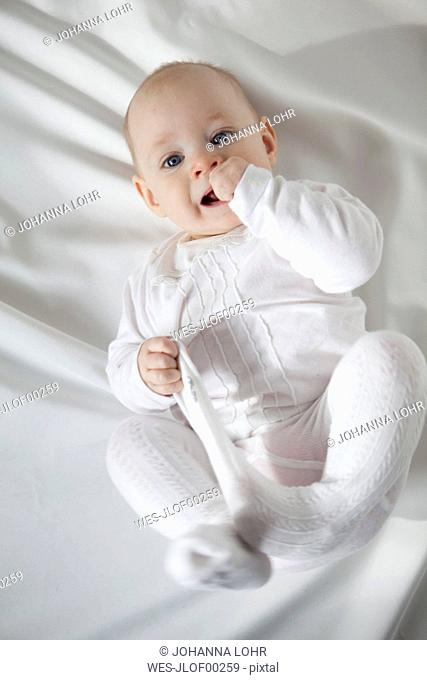 Portrait of baby girl dressed in white