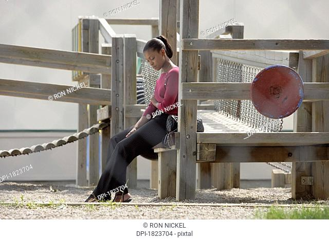 Woman alone in a playground