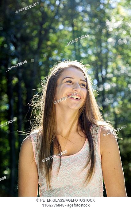 Smiling teenage girl on a sunny day