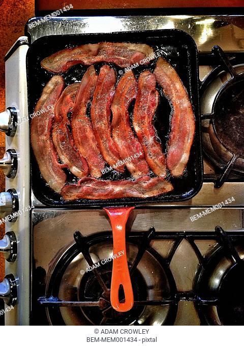 Bacon frying in pan