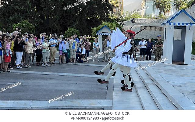 Athens Greece Changing of the Guard at Parliament and unknown soldier grave with soldiers in traditional outfits and marching with crowds of tourists