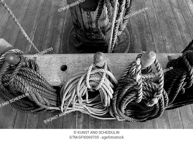 Belaying pins with ropes on a tall ship
