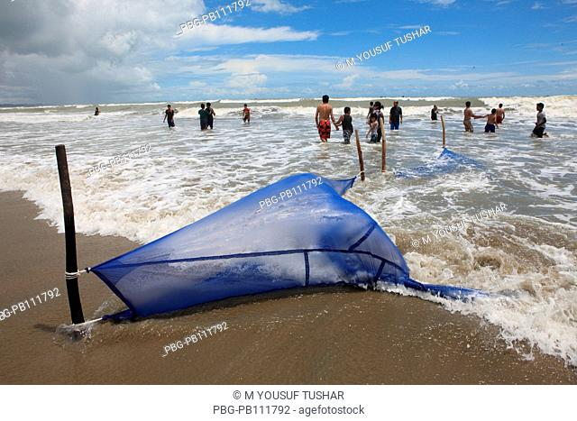 fisherman cacthing Shrimp at The worlds longest stretch of uninterrupted beach has made Coxs Bazar, a popular tourist spot Bangladesh