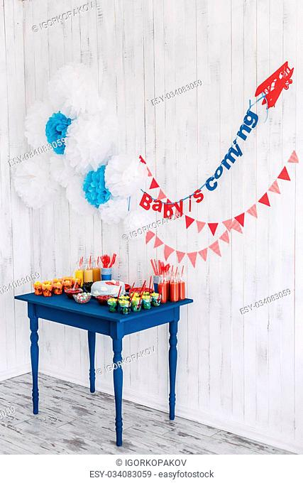Candy bar bottle with red tubes on a blue table