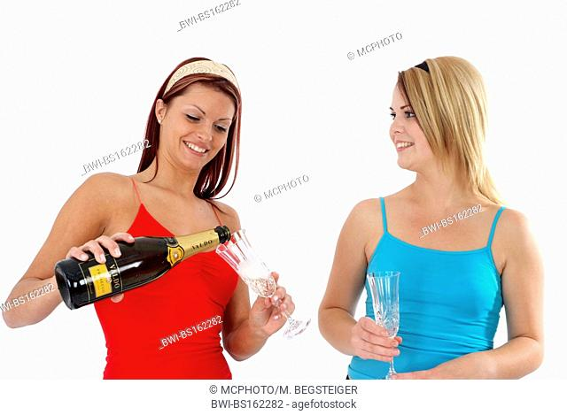 young women drinking sparkling wine