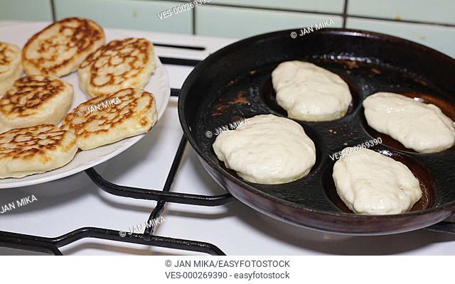 Closeup of pancakes on frying pan