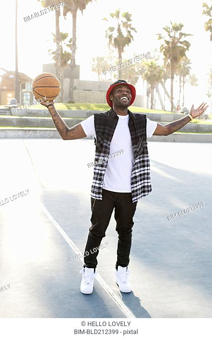African American man standing on basketball court