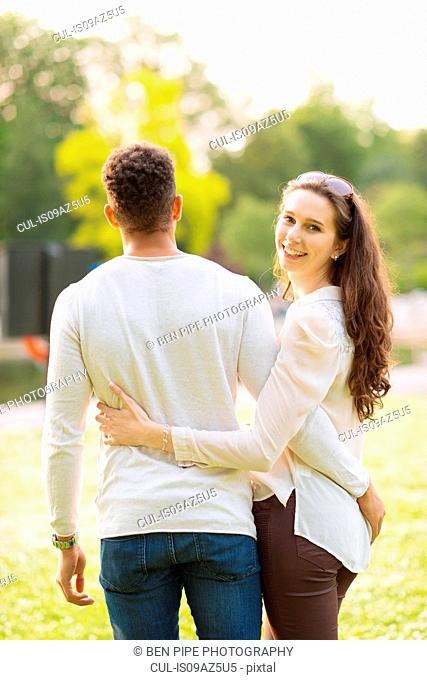 Rear view of couple with arms around each