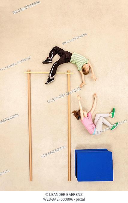 Children training high jump