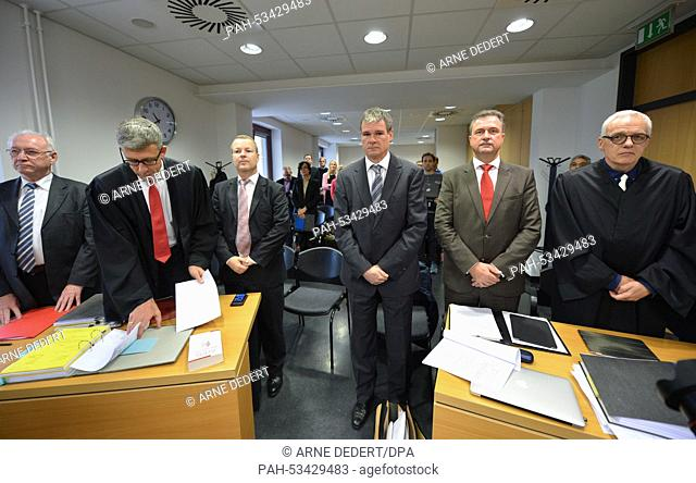 Leader of the negotiations Werner Bayreuther (L-R), lawyer Thomas Ubber, head of the department labour law of the Deutsche Bahn Michael Fritz
