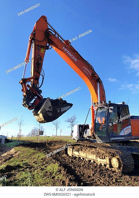 Excavator at blue sky in Scania, Sweden
