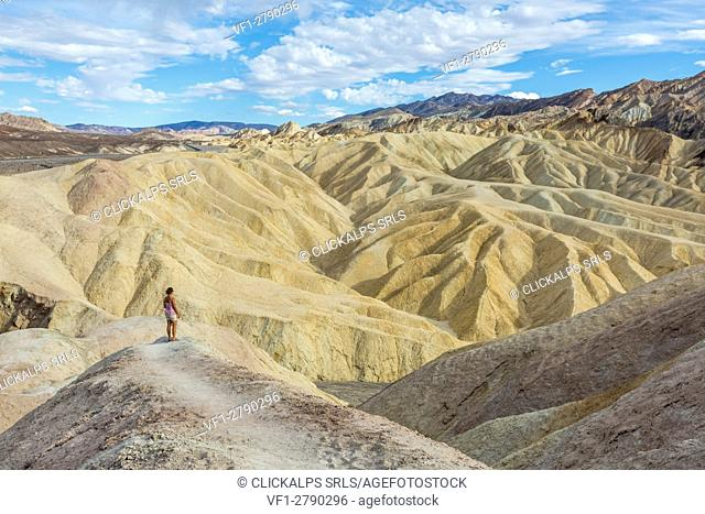 Woman admiring the landscape. Zabriskie Point, Death Valley National Park, Inyo County, California, USA