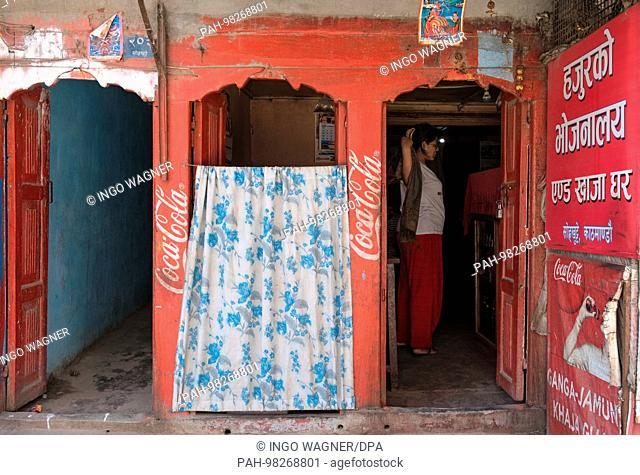 A woman is on April 25, 2017 in a snackbar in the district of Thamel of the Nepali capital Kathmandu. | usage worldwide. - Kathmandu/Nepal
