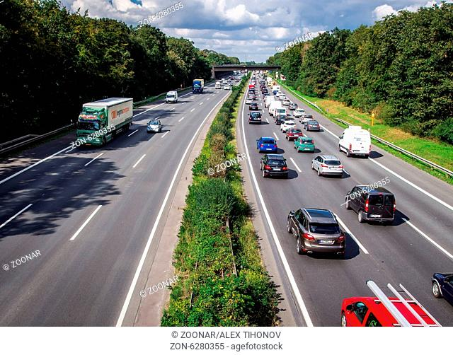 BOCHUM, GERMANY - SEPTEMBER 11, 2014: Typical scene during rush hour in a traffic jam with rows of cars