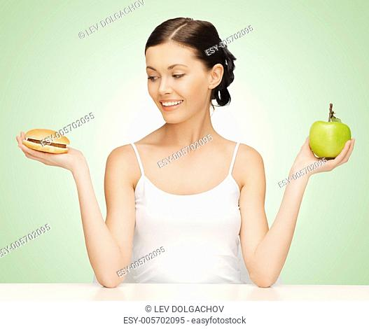 picture of beautiful woman with hamburger and apple
