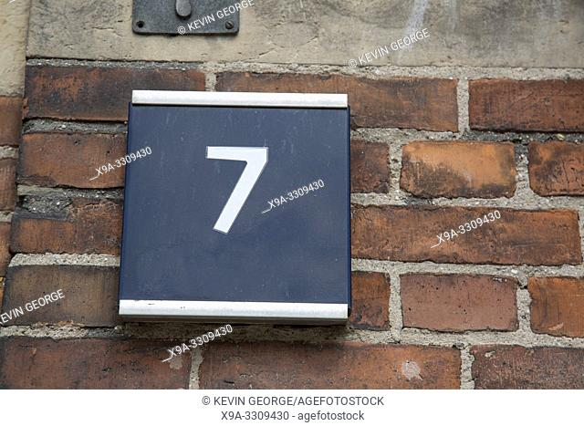 Number Seven on Brick Wall
