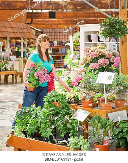 Caucasian woman shopping in nursery