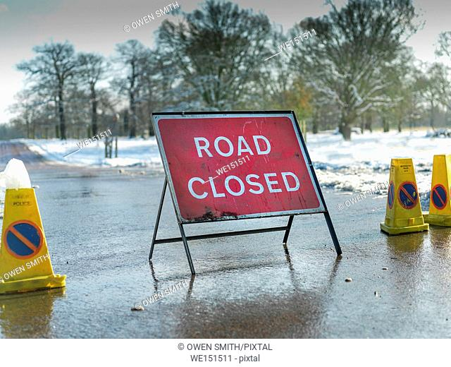 Road Closed sign on snow bound road