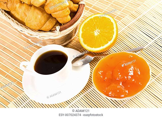 early breakfast, orange, coffee, croissants and jam