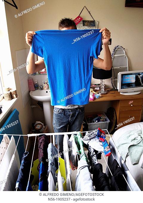 Man showing blue T-shirt
