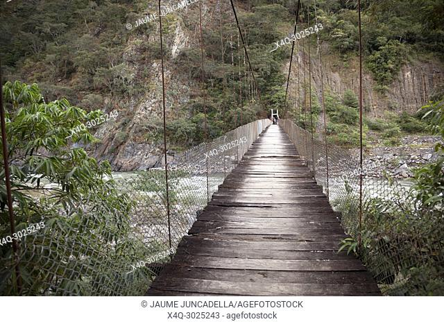 People spend 15 days walking by Inca's way to MachuPicchu. Travellers crossing a river to Aguas Calientes over a bridge