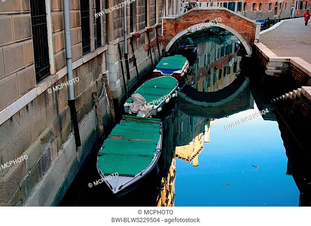 covered boat in a canal in Venice, Italy, Venice