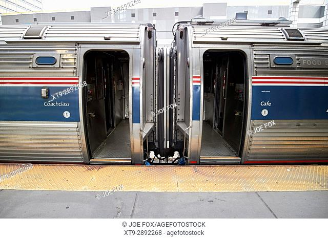 amtrak coachclass carriage and cafe car at station platform with open doors Boston USA