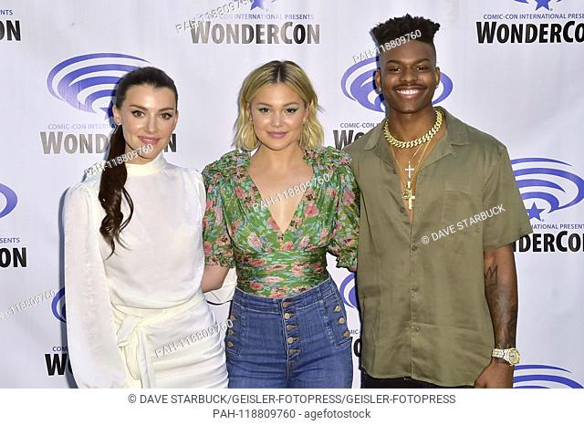 Emma Lahana, Olivia Holt and Aubrey Joseph at the Photocall Freeform TV series 'Marvel's Cloak and Dagger / Cloak & Dagger' at WonderCon 2019 at the Anaheim...