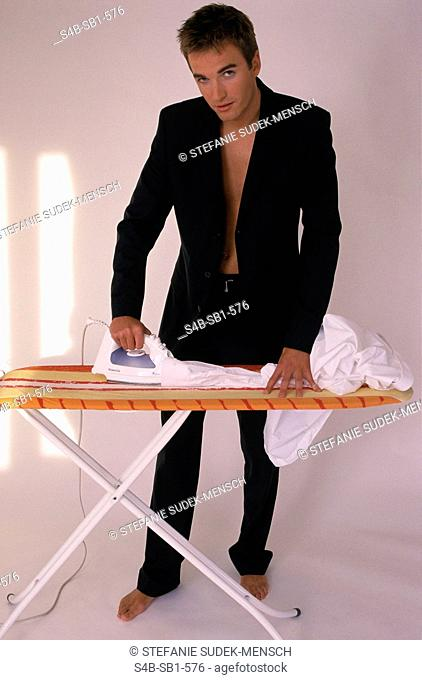 Young ironing Businessman