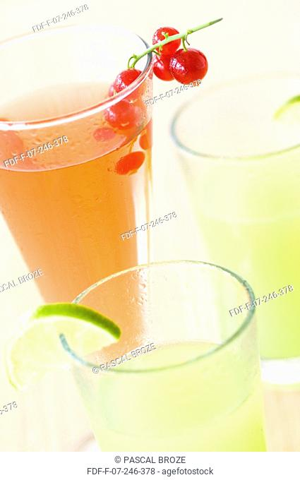 Close-up of glasses of lemonade and gooseberry juice
