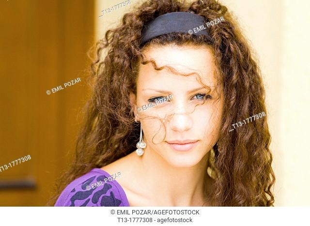Messy hair before her face girl portrait