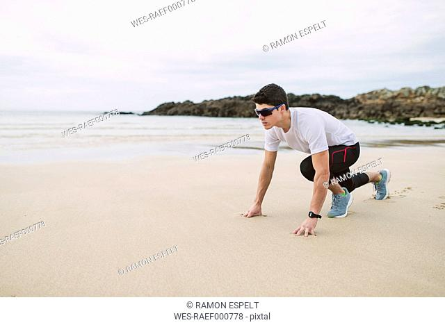 Young athlete training on the beach