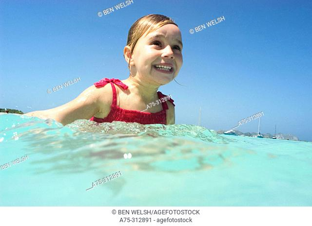 young girl in caribbean sea