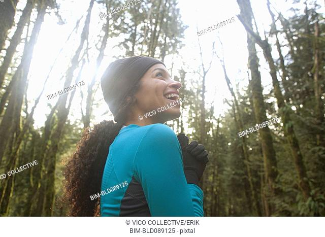 Laughing mixed race woman in remote forest
