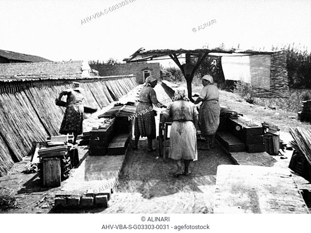 Workers to work within Galotti Furnace for the production of bricks, which now houses the Museum of Industrial Heritage of Bologna, shot 1930 ca